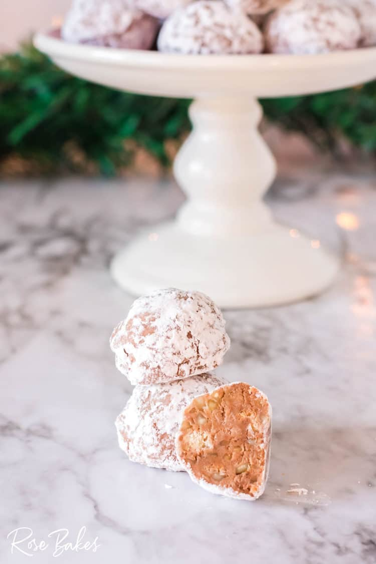 Whiskey Kisses or Whiskey Balls on a table with platter in background