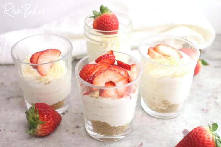 No-Bake Cheesecake Cups Recipe in cups with strawberries on top