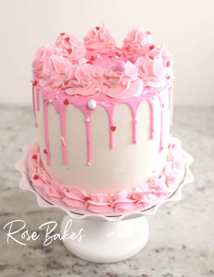 finished canned frosting drip cake - white cake with pink drip, pink buttercream and valentine's sprinkles