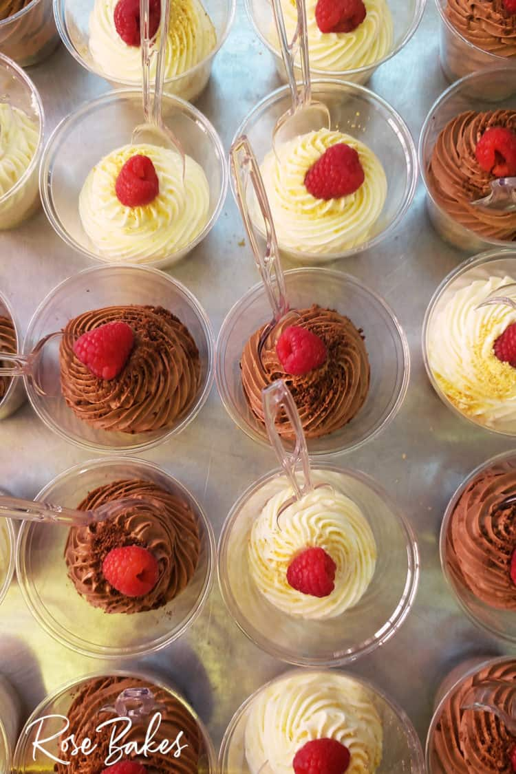 No-Bake Cheesecake Cups and No-Bake Chocolate Cheesecake Cups with raspberries on top and clear spoons