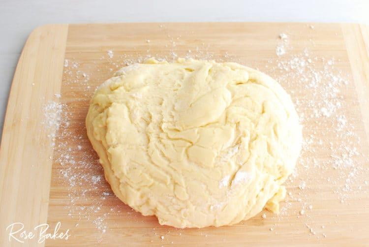 Raspberry Cinnamon Rolls dough ball on cutting board