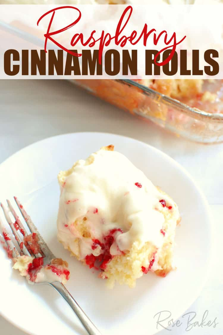 Raspberry Cinnamon Rolls on white plate with fork