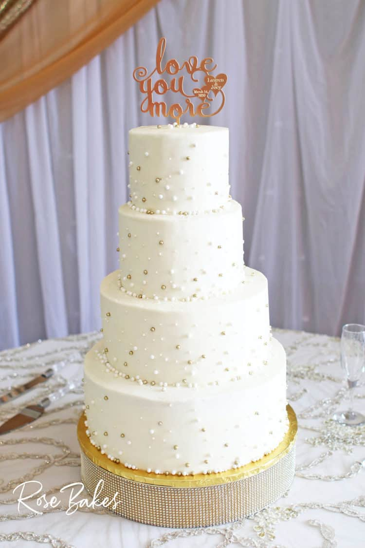 White Wedding Cake with Gold and White Pearls