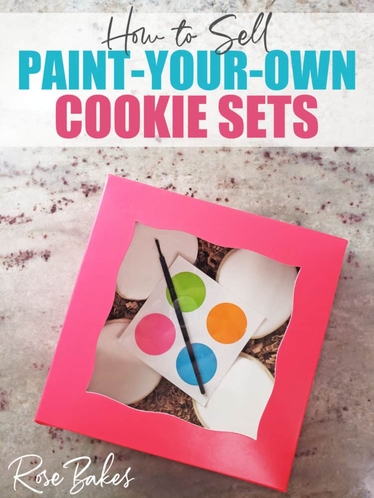 How to Sell Paint Your Own (PYO) Cookie Sets - No Cookie Decorating Required!  A pink box of plain white cookies with a palette and paintbrush for clients.