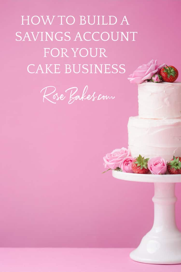 Tall, white, milk glass cake stand with a 2 tier buttercream frosted cake with pink roses and fresh strawberries on top and around the bottom.  The background is pink and next to the cake is the text, How to build a savings account for your cake business RoseBakes.com