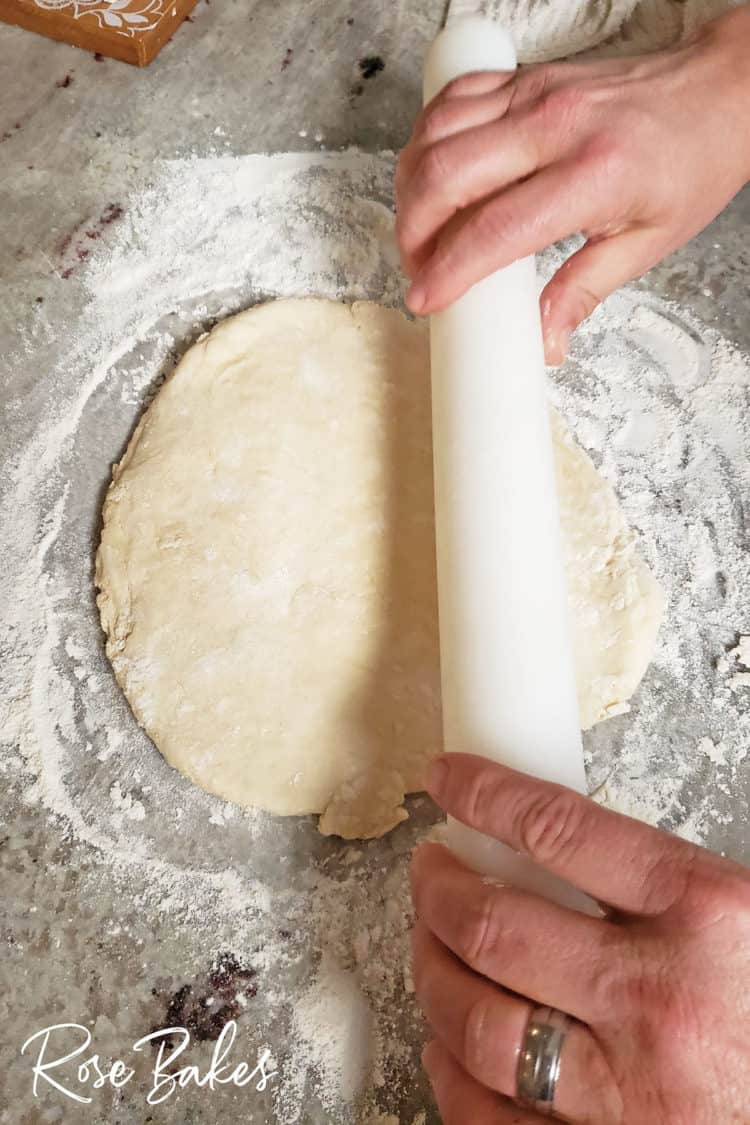 rolling out indian fry bread dough on floured surface