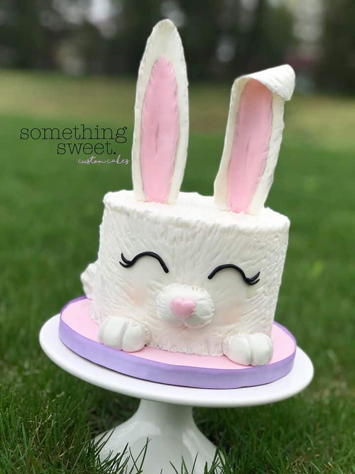 Easter Bunny Cake on cake stand in grass
