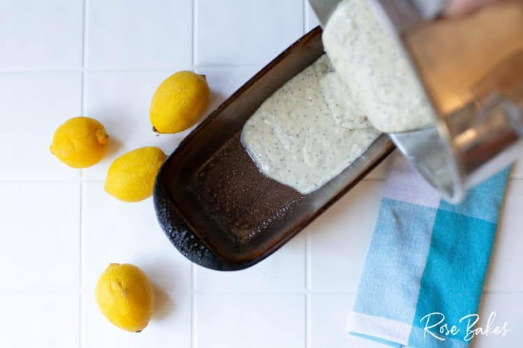 Pouring Lemon Poppyseed Loaf batter into loaf pan