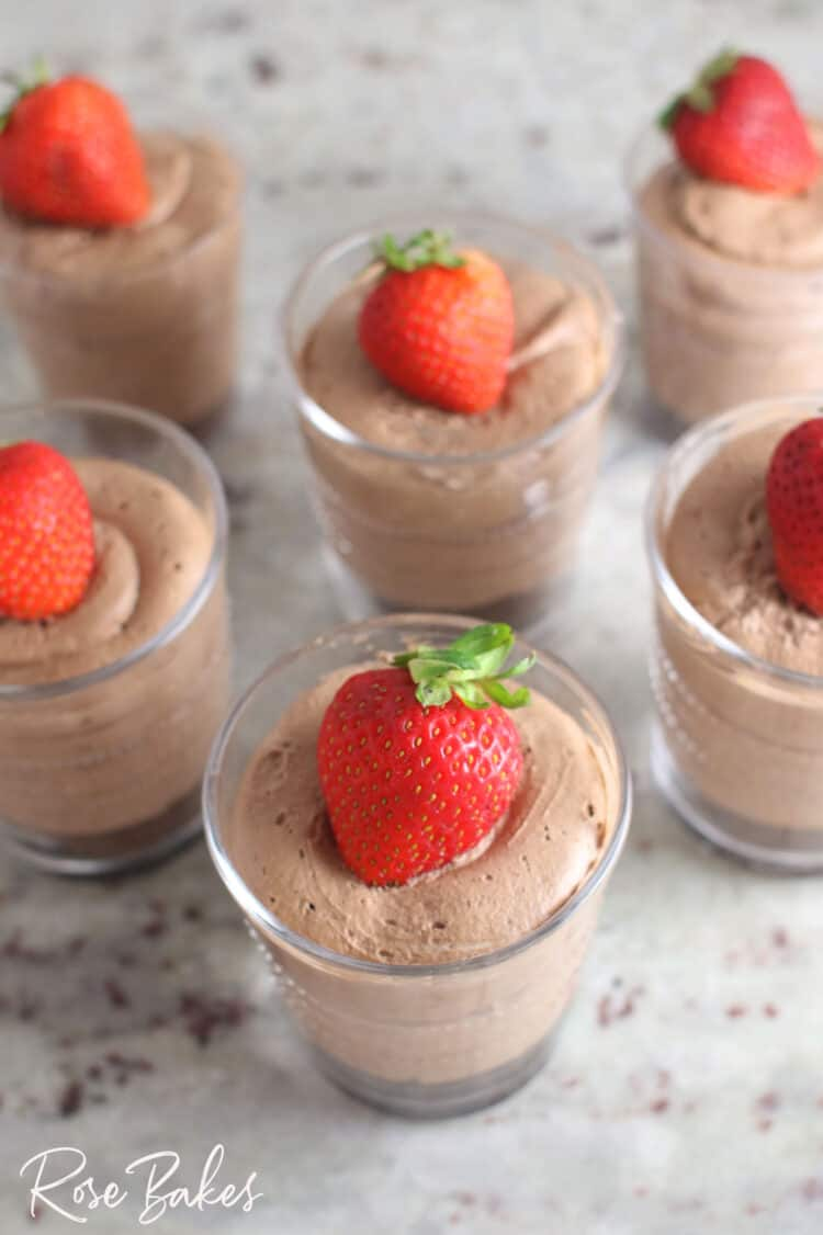 Creamy No-Bake Chocolate Cheesecake Cup in small clearglass with cookie crust and topped with strawberry