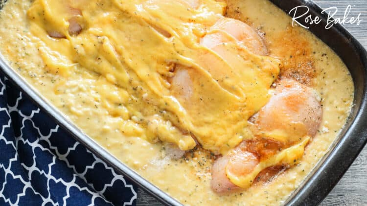 cheese soup spread over chicken breasts