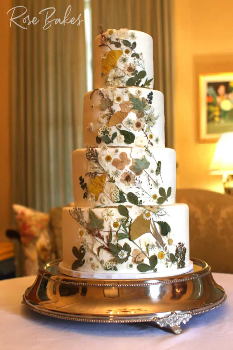 Pressed Flowers Wedding Cake on a silver stand