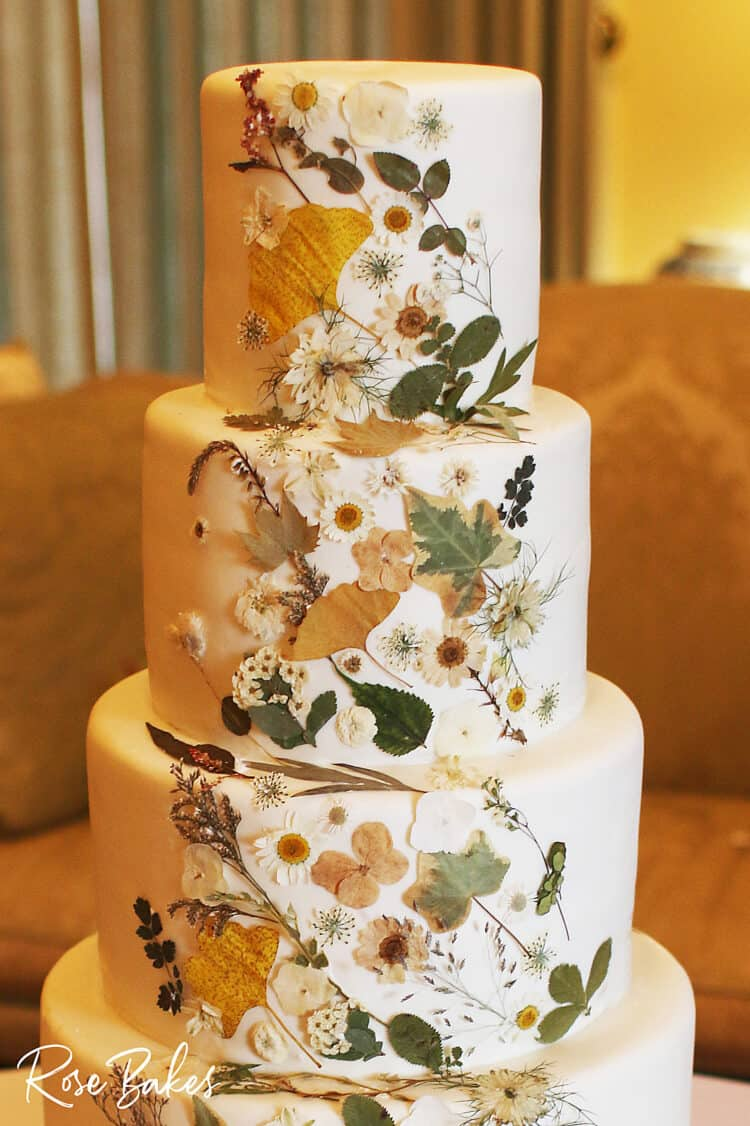 pressed flowers on a wedding cake