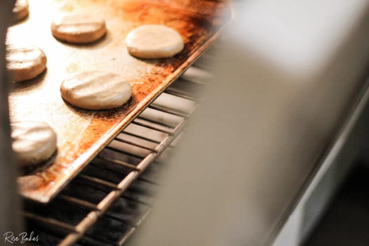 Cookies being put into an oven