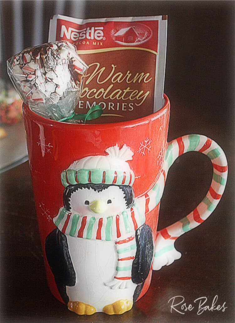 Wrapped Peppermint Dipped Marshmallows in Christmas mug with packet of hot cocoa mix for gift-giving