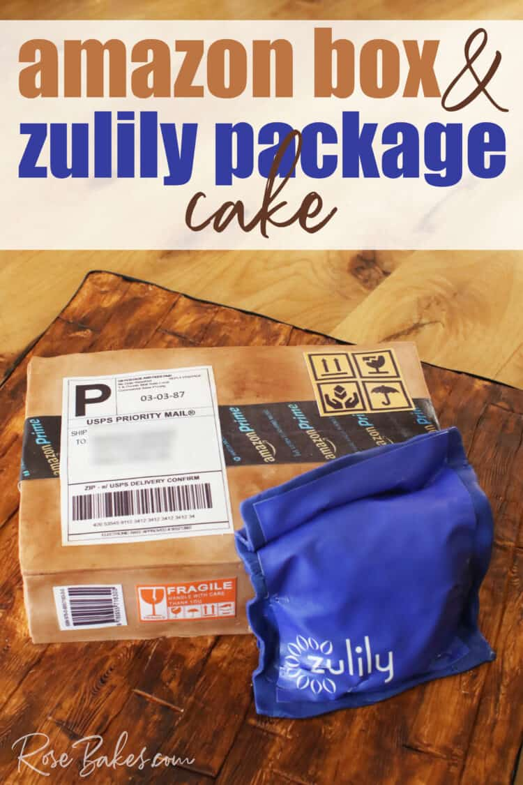 Cake shaped like and amazon cardboard shipping box and a blue zulily package.  The cake is sitting on a cake board that looks like wood made from fondant and hand painting.