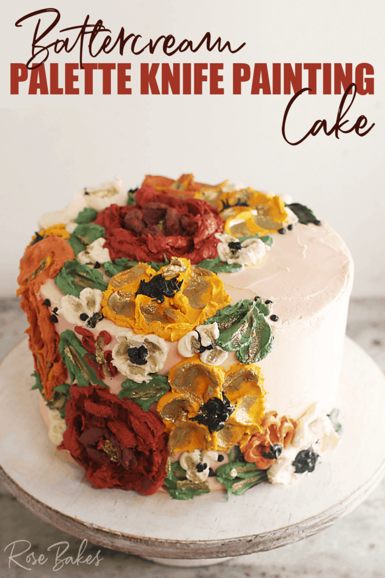 """Cake frosted white with green leaves and red, yellow, and white buttercream flowers created with palette knives on one side of the top of the cake and cascading down the side of the cake.  Text at the top of the image reads """"Buttercream Palette Knife Painting Cake"""""""