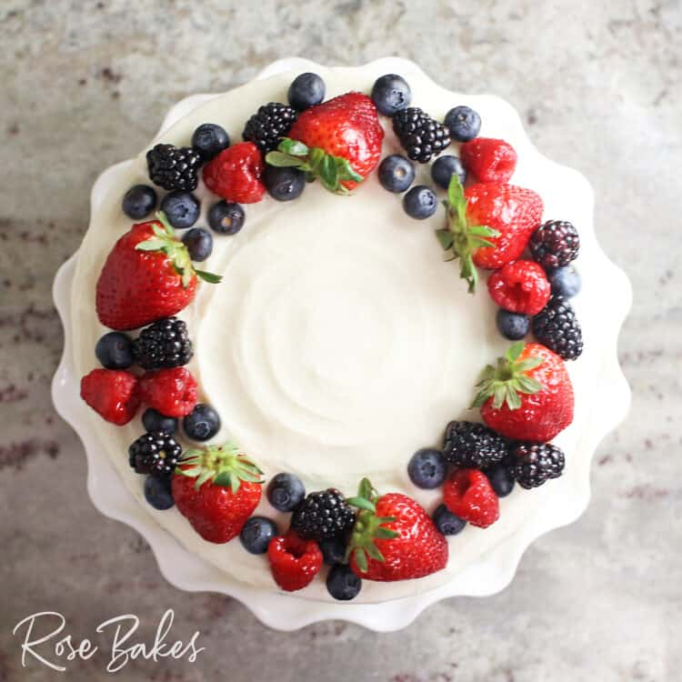 Top view of a chantilly cake with a fresh berry wreath