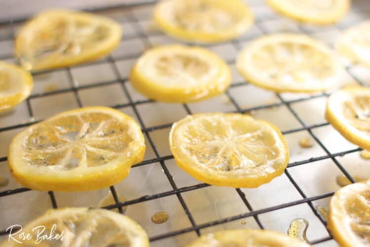 cooked candied lemon slices cooling on a cooling wack