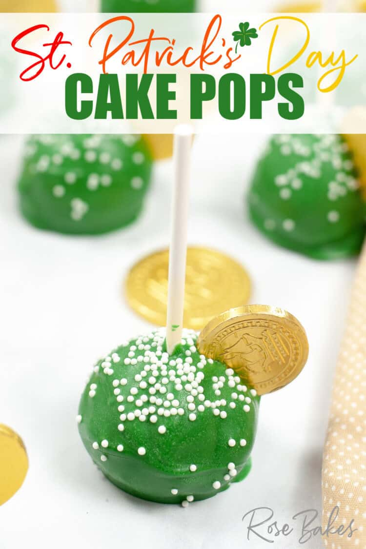 Green cake pop with white nonpareil sprinkles and a gold coin on top.