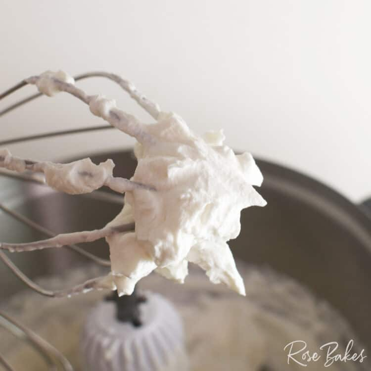 Whipped Cream on the end of a whisk attachment of a Bosch Mixer.