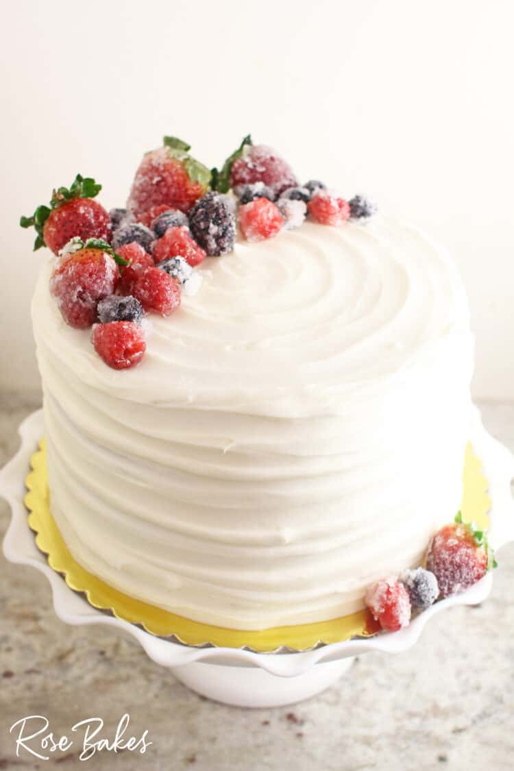 Chantilly cake with textured buttercream and topped with sugared berries.