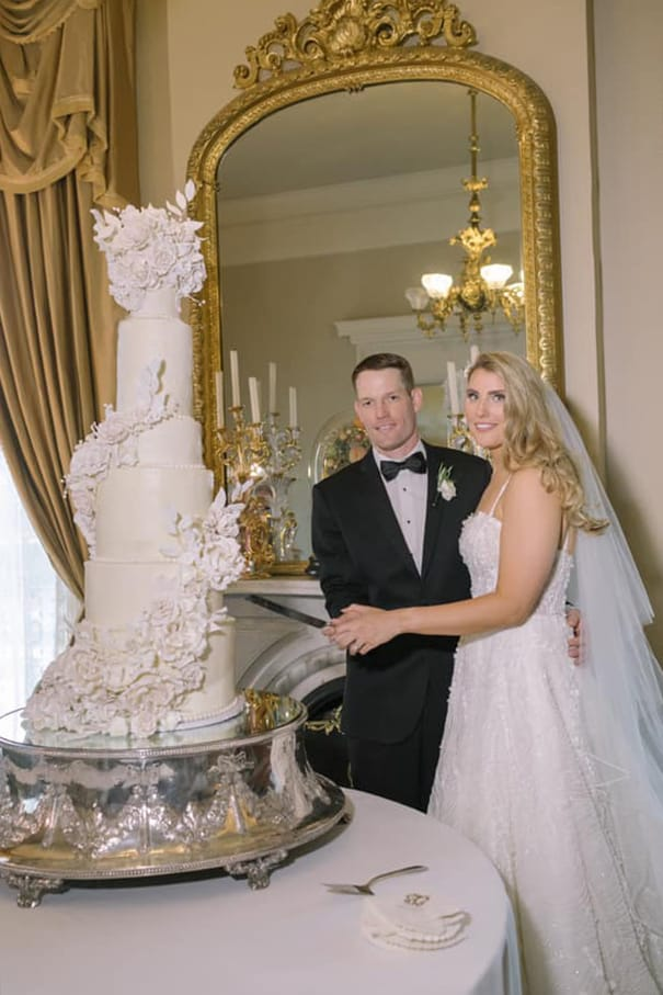 Bride and Groom about to cut 9 tier cake