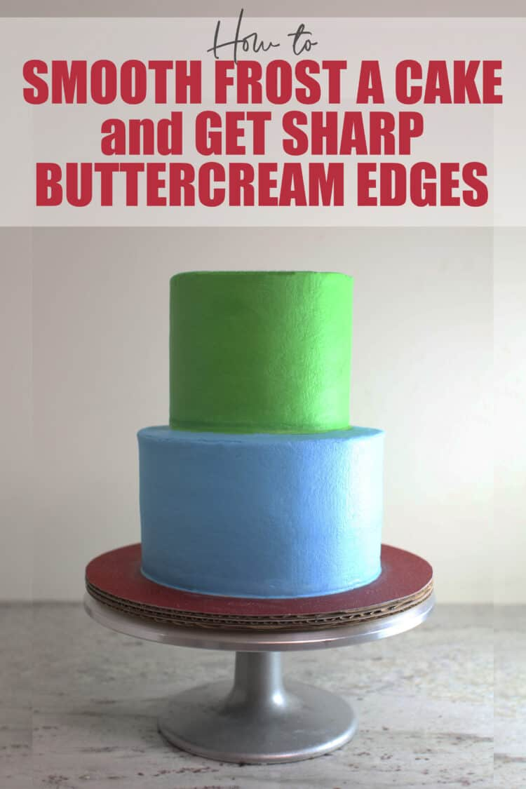 2 tier green and blue buttercream cake with smooth sides and sharp edges on silver cake stand