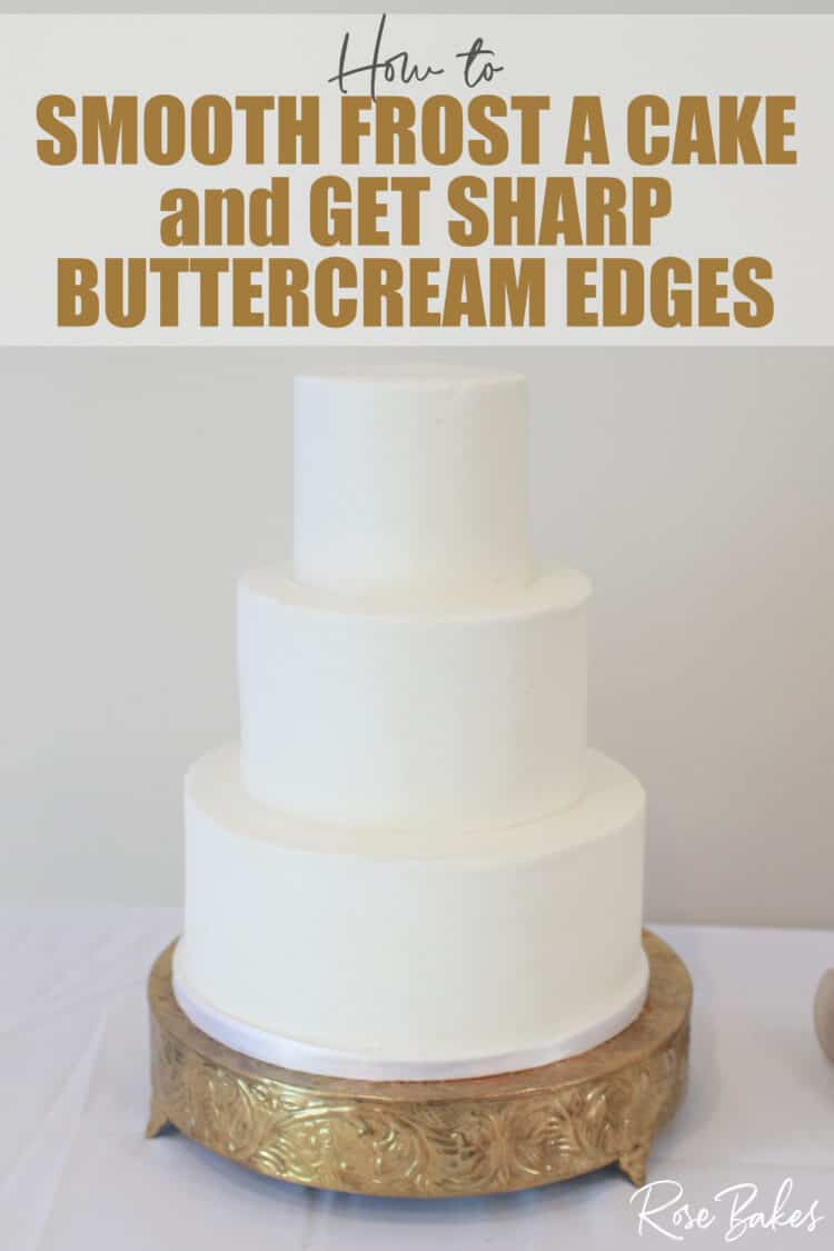 crisp white buttercream 3 tier cake on gold cake stand with sharp edges  with title how to smooth frost a cake and get sharp buttercream edges