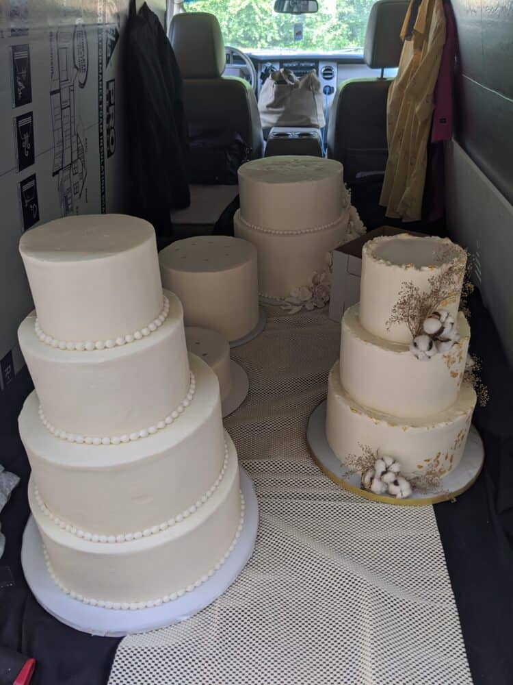 multiple cake tiers seperated in back of vehicle for transport