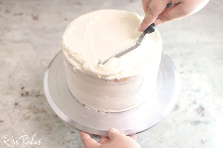 buttercream icing being spread with offset spatula