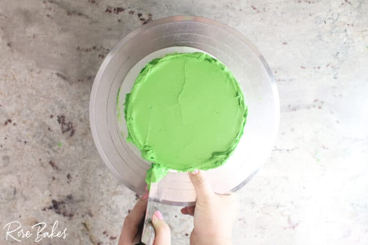bench scraper smoothing green icing