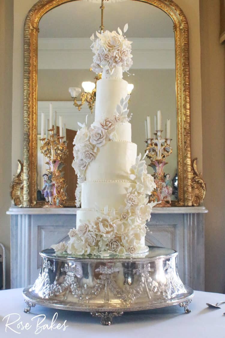 Tall Elegant Luxury wedding cake 9 tiers on silver cake stand with white sugar flowers