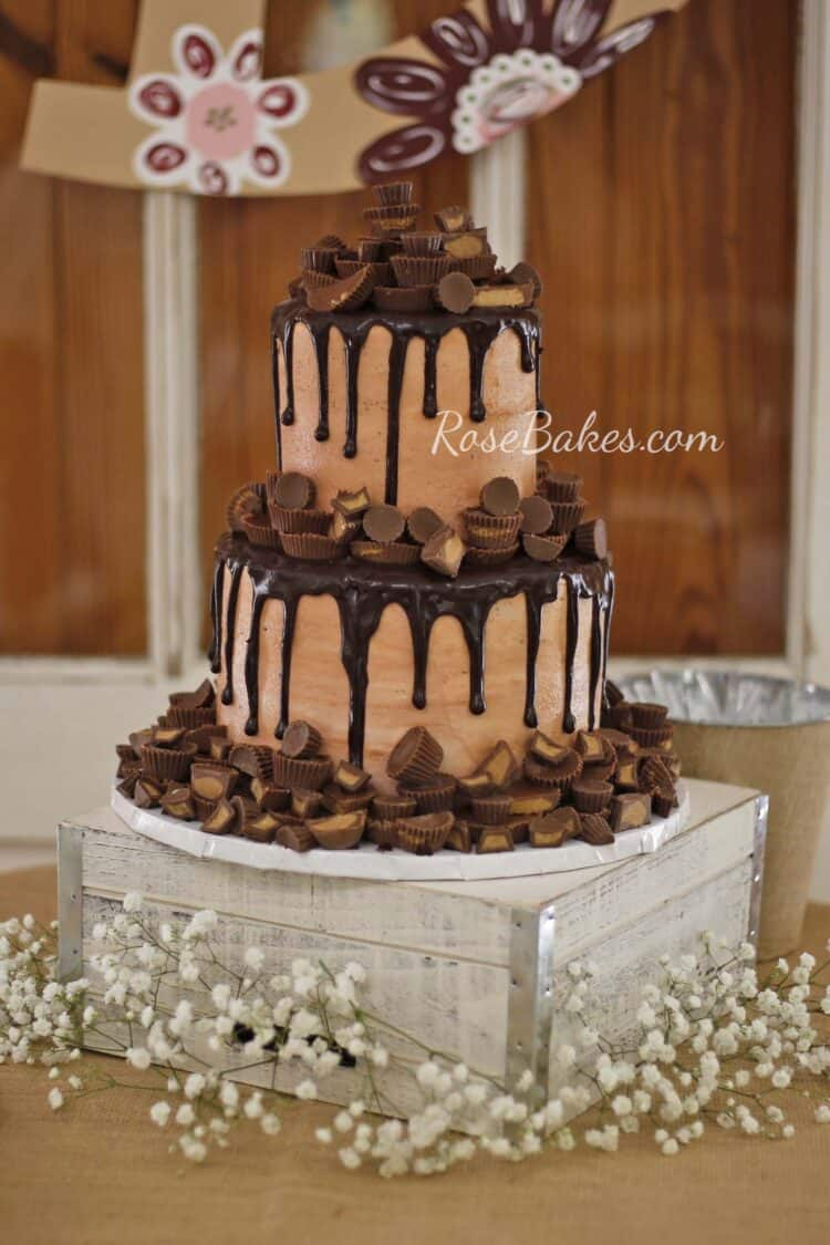 2 tier milk chocolate icing grooms cake with dark chocolate drizzle and peanut butter cups